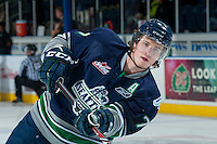 KELOWNA, CANADA -FEBRUARY 10: Shea Theodore #17 of the Seattle Thunderbirds takes a shot on net during warm up against the Kelowna Rockets on February 10, 2014 at Prospera Place in Kelowna, British Columbia, Canada.   (Photo by Marissa Baecker/Getty Images)  *** Local Caption *** Shea Theodore;