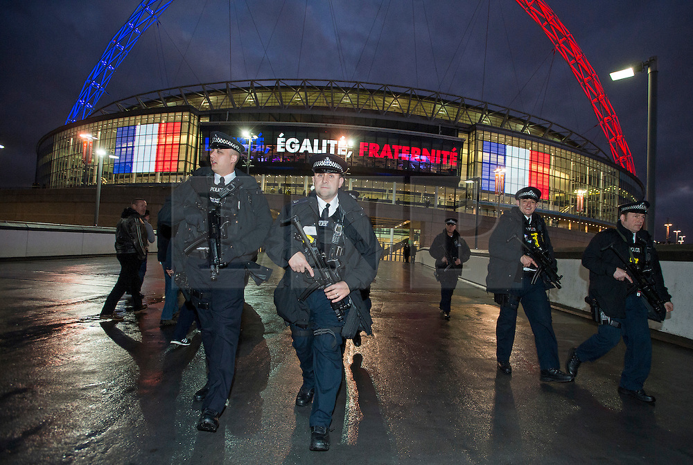 © Licensed to London News Pictures. 17/11/2015. London, UK. Armed police officers watch over fans at Wembley Stadium ahead of a friendly game between England and France. The UK has been on a heightened security alert following multiple terrorist attacks in Paris last week in which over 120 people were killed. Photo credit: Ben Cawthra/LNP