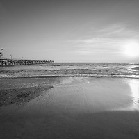 San Clemente pier at sunset black and white photo. San Clemente is a popular beach city along the Pacific Ocean in Orange County Southern California in the States of America. Copyright ⓒ 2017 Paul Velgos with all rights reserved.