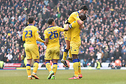 Leeds United's on loan Midfielder, Liam Bridcutta and Leeds United Defender, Souleymane Bamba celebrate a goal during the Sky Bet Championship match between Blackburn Rovers and Leeds United at Ewood Park, Blackburn, England on 12 March 2016. Photo by Mark Pollitt.