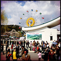 A theme park with a large ferris wheel during May Day in Pyongyang, North Korea.