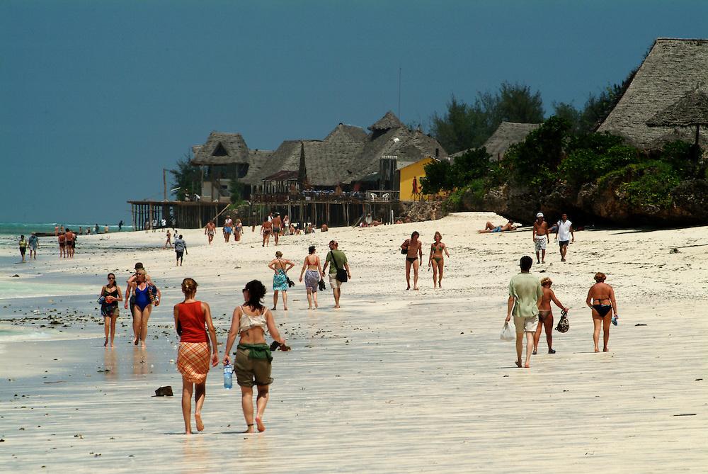 Africa. Tanzania. Zanazibar. Nungwi beach..Tourist at low tide..CD0011