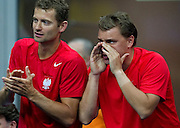 (L) Mariusz Fyrstenberg & (R) Marcin Matkowski support their teammate Lukasz Kubot while his match during first day of the BNP Paribas Davis Cup 2013 between Poland and South Africa at MOSiR Hall in Zielona Gora on April 05, 2013...Poland, Zielona Gora, April 05, 2013..Picture also available in RAW (NEF) or TIFF format on special request...For editorial use only. Any commercial or promotional use requires permission...Photo by © Adam Nurkiewicz / Mediasport