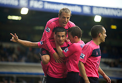BIRMINGHAM, ENGLAND - Saturday, October 2, 2010: Everton's Tim Cahill celebrates scoring the second goal against Birmingham City in the last minute of injury time with team-mates captain Phil Neville and Leighton Baines during the Premiership match at St Andrews. (Photo by David Rawcliffe/Propaganda)