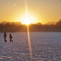 EDINBURGH, UK - 8th January 2010:  A couple walk to work through Edinburgh meadows in early morning sunrise as UK temperatures remain at sub-zero after the Met Office recorded the winter's coldest day yet..Temperatures  plunged to -22.3C in the Highlands.. (Photograph: Michael Hughes/MAVERICK)