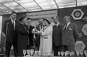 10/05/1965<br /> 05/10/1965<br /> 10 May 1965<br /> Mrs. T. W. Irvine, right, wife of Wills of Dublin and Cork factory manager, presents the winner trophy of the Kingsway Amateur Handicap Hurdle to Mrs. C. M. Stewart on behalf of owner. Also pictured are, left to right, Mr. D. R. Mott, Wills managing director; Mr. D. K. Weld, jockey; Mr. Weld, trainer; Mr. F. Clark, Leopardstown Racecourse manager; and Mr. T. W. Irvine.