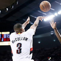 25 April 2016: Portland Trail Blazers guard C.J. McCollum (3) takes a jump shot over Los Angeles Clippers forward Jeff Green (8) during the Portland Trail Blazers 98-84 victory over the Los Angeles Clippers, during Game Four of the Western Conference Quarterfinals of the NBA Playoffs at the Moda Center, Portland, Oregon, USA.