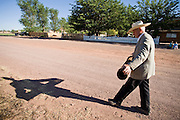 "June 16, 2008 -- COLORADO CITY, AZ: JOSEPH JESSOP, 86 years old, carries a water filter to his pickup truck in Colorado City, AZ. Jessop, a polygamist and member of the FLDS, was arrested during the Short Creek Raid in 1953 and had his wives and children taken from him for two years. Colorado City and neighboring town of Hildale, UT, are home to the Fundamentalist Church of Jesus Christ of Latter Day Saints (FLDS) which split from the mainstream Church of Jesus Christ of Latter Day Saints (Mormons) after the Mormons banned plural marriage (polygamy) in 1890 so that Utah could gain statehood into the United States. The FLDS Prophet (leader), Warren Jeffs, has been convicted in Utah of ""rape as an accomplice"" for arranging the marriage of teenage girl to her cousin and is currently on trial for similar, those less serious, charges in Arizona. After Texas child protection authorities raided the Yearning for Zion Ranch, (the FLDS compound in Eldorado, TX) many members of the FLDS community in Colorado City/Hildale fear either Arizona or Utah authorities could raid their homes in the same way. Older members of the community still remember the Short Creek Raid of 1953 when Arizona authorities using National Guard troops, raided the community, arresting the men and placing women and children in ""protective"" custody. After two years in foster care, the women and children returned to their homes. After the raid, the FLDS Church eliminated any connection to the ""Short Creek raid"" by renaming their town Colorado City in Arizona and Hildale in Utah.   Photo by Jack Kurtz"