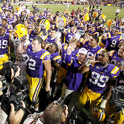 November 12, 2011; Baton Rouge, LA, USA;  LSU Tigers head coach Les Miles and his team celebrate following a win over the Western Kentucky Hilltoppers at Tiger Stadium.  Mandatory Credit: Derick E. Hingle-US PRESSWIRE