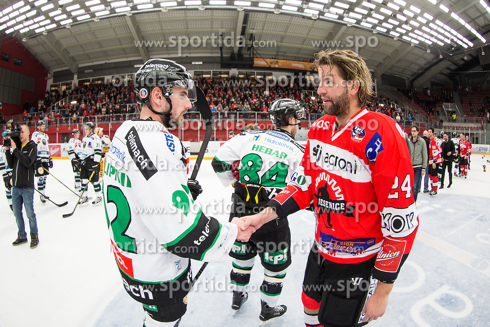 Anze Terlikar of HDD Jesenice and Matic Podlipnik of HDD Olimpija during ice hockey match between HDD SIJ Acroni Jesenice and HDD Telemach Olimpija in 4th leg of Finals of Slovenian National Championship 2014/2015, on April 15, 2015 in Podmezakla, Jesenice, Slovenia. Photo by Grega Valancic / Sportida