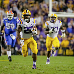 Oct 12, 2019; Baton Rouge, LA, USA; LSU Tigers running back Clyde Edwards-Helaire (22) runs against the Florida Gators during the first quarter at Tiger Stadium. Mandatory Credit: Derick E. Hingle-USA TODAY Sports