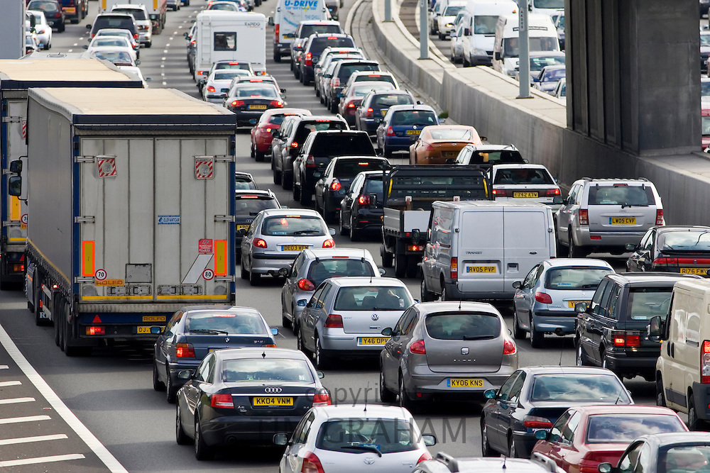 Traffic, cars and trucks, stuck at a standstill in both directions on M25 motorway, London, United Kingdom