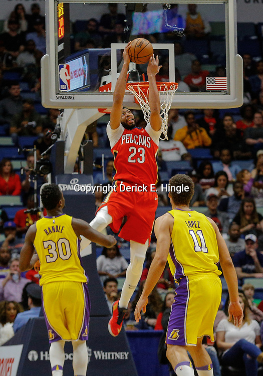 Feb 14, 2018; New Orleans, LA, USA; New Orleans Pelicans forward Anthony Davis (23) dunks over Los Angeles Lakers forward Julius Randle (30) and center Brook Lopez (11) during the first quarter at the Smoothie King Center. Mandatory Credit: Derick E. Hingle-USA TODAY Sports