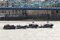 © Licensed to London News Pictures. 23/10/2018. London, UK.  Four military RIB's travel at speed under Tower Bridge during a rehearsal for a display tomorrow when the Royal Marines and Royal Netherlands Marines will stage a joint on water capability demonstration with blank ammunition. As part of the Dutch state visit, King Willem-Alexander and Queen Máxima will attend the Dutch ship HNLMS Zeeland, which is anchored next to HMS Belfast. They will join The Duke of Kent on board and will be given a 10 minute display of the Royal Marines and Royal Netherlands Marines staging a joint on water capability demonstration.Photo credit: Vickie Flores/LNP