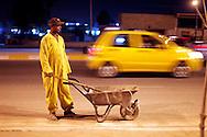 10/10/2014 -- Kirkuk, Iraq -- A Bangladeshi worker cleans the street at night in the Iskan neighborhood.