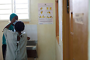 Doctor Ivan Nyenje scrubbing in ready for a caesarean section at Kasangati Health Centre in Uganda.