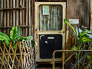 15 SEPTEMBER 2016 - BANGKOK, THAILAND: A locked door on an abandoned home in the Pom Mahakan community on the day the resident moved out. Forty-three families still live in the Pom Mahakan Fort community. The city of Bangkok has given them provisional permission to stay, but city officials say the permission could be rescinded and the city go ahead with the evictions. The residents of the historic fort have barricaded most of the gates into the fort and are joined every day by community activists from around Bangkok who support their efforts to stay.                     PHOTO BY JACK KURTZ