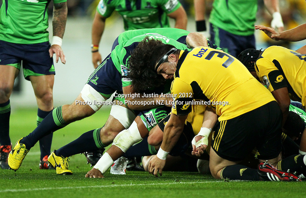 Hurricanes' Jeffery Toomaga-Allen collides with Highlanders' Nick Crosswell during the 2012 Super Rugby season, Hurricanes v Highlanders at Westpac Stadium, Wellington, New Zealand on Saturday 17 March 2012. Photo: Justin Arthur / Photosport.co.nz
