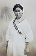 young adult Japanese woman WWII volunteer begiinning of 1940s. Sash, Kokubo fujinkai - wartime social organization