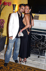 Model SOPHIE ANDERTON and MR MARK ALEXIOU at a party to celebrate the launch of Michelle Watches held at the Blue Bar, The Berkeley Hotel, London on 7th October 2004.<br />