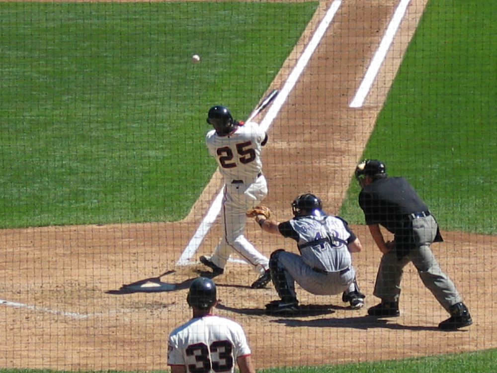 Barry Bonds hitting a pitch against the Colorado Rockies