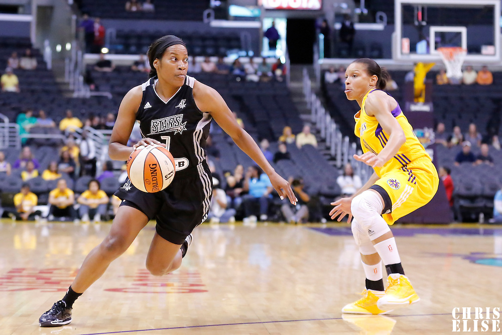 25 May 2014: San Antonio Stars guard Jia Perkins (7) drives past Los Angeles Sparks guard/forward Armintie Herrington (22) during the Los Angeles Sparks 83-62 victory over the San Antonio Stars, at the Staples Center, Los Angeles, California, USA.