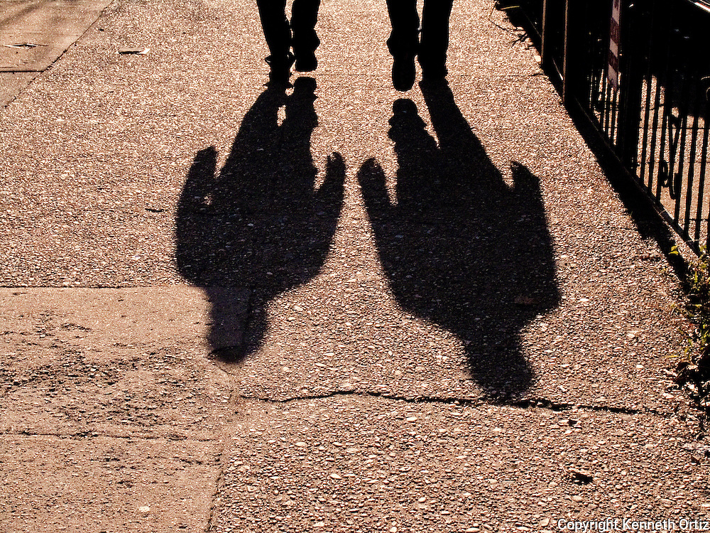 A shot of two shadows walking down the streets of Astoria Queens.