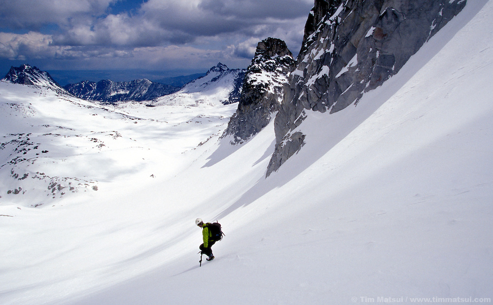 Andreas Schmidt descends to Asgaard Pass from Dragontail Peak. The snow covered Enchantment Lakes are in the distance.