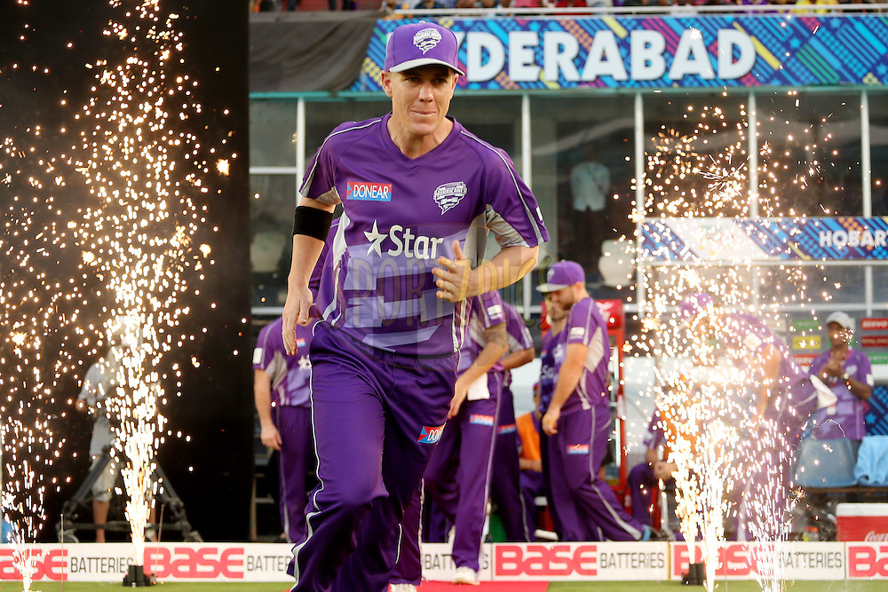 Hobart Hurricanes running out onto the field for the second innings during the first semi final match of the Oppo Champions League Twenty20 between the Kolkata Knight Riders and the Hobart Hurricanes held at the Rajiv Gandhi Cricket Stadium, Hyderabad, India on the 2nd October 2014. Photo by:  Jacques Rossouw / Sportzpics/ CLT20<br /> <br /> <br /> Image use is subject to the terms and conditions as laid out by the BCCI/ CLT20.  The terms and conditions can be downloaded here:<br /> <br /> http://sportzpics.photoshelter.com/gallery/CLT20-Image-Terms-and-Conditions-2014/G0000IfNJn535VPU/C0000QhhKadWcjYs