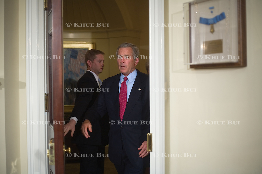 President Bush introduces Mary Peters as his nominee to become Secretary of Transportation in the Roosevelt Room of the White House, Tuesday, September 5, 2006.  Holding door open is Personal Aide to the President Jared Weinstein...Photo by Khue Bui