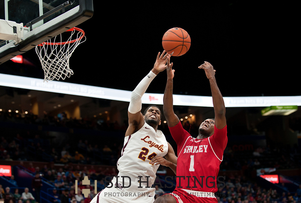 Loyola University Chicago basketball player Aundre Jackson (24) battles Bradley University's Donte Thomas (1) during the semifinals of the Missouri Valley Conference men's basketball tournament at Scottrade Center in St. Louis Saturday, March 3, 2018. LUC won, 62-54. Photo © copyright 2018 Sid Hastings.
