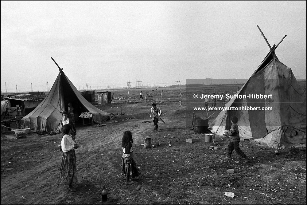 Children in the Kalderash Roma camp of Sintesti, near Bucharest. The camp is home to a few hundred Roma whose principle manner of employment is metal working.