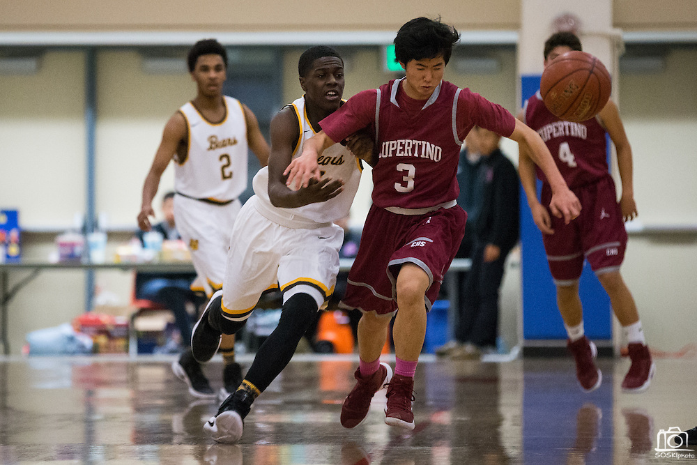 Mission Bears guard Tyrese Johnson (4) battles for a loose ball against Cupertino during the Fukushima Invitational at Independence High School in San Jose, Calif., on December 7, 2016. (Stan Olszewski/Special to S.F. Examiner)