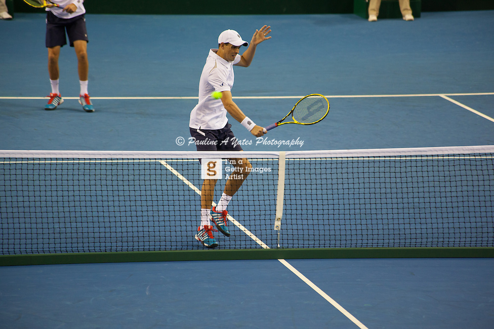 The Bryan Brothers return a volley to Jamie Murray and Dominic Inglot during the Davis Cup Doubles match in Glasgow