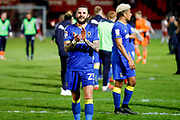 AFC Wimbledon defender Callum Kennedy (23)  applauds the visiting fans after securing AFC Wimbledon League One status with a point during the EFL Sky Bet League 1 match between Doncaster Rovers and AFC Wimbledon at the Keepmoat Stadium, Doncaster, England on 1 May 2018. Picture by Simon Davies.
