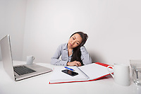 Bored businesswoman working at office desk
