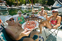 Fresh cooked prawns and a beautiful warm summer afternoon on the back of a boat, west coast style!  Brentwood Bay, Vancouver Island, British Columbia, Canada.