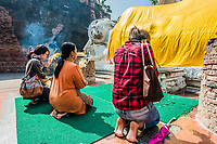 Bangkok, Thailand - December 29, 2013: people praying to the reclining buddha statue at Wat Yai Chai Mongkhon Ayutthaya in Bangkok, Thailand on december 29th, 2013