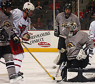 10/23/04 Omaha, Neb. University of  Nebraska at Omaha's  Mike Lefley watches a Scott Parse shot go past West MIch goalie Eric Marvin for the first goal of the game Saturday night. (chris machian/Prarie Pixel Group)