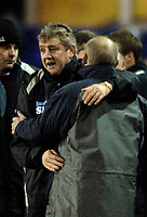 Photo: Glyn Thomas.<br />Birmingham City v Reading. The FA Cup. 07/02/2006.<br />Birmingham's manager Steve Bruce (L) embraces his counterpart from Reading Steve Coppell at the final whistle.