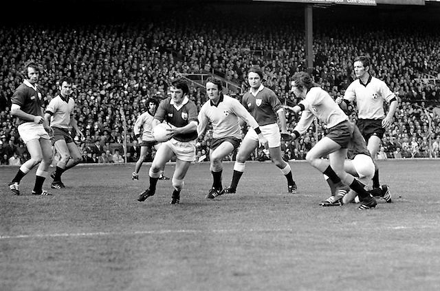 Galway's J Waldron gets in a clearance despite the efforts of Anton O'Toole to block down the kick during the All Ireland Senior Gaelic Football Championship Final Dublin V Galway at Croke Park on the 22nd September 1974. Dublin 0-14 Galway 1-06.