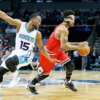 03 November 2015: Chicago Bulls guard Derrick Rose (1) drives past Charlotte Hornets guard Kemba Walker (15) during the Charlotte Hornets  130-105 victory over the Chicago Bulls, at the Time Warner Cable Arena, in Charlotte, North Carolina, USA.