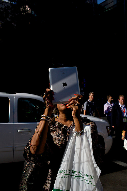 A woman uses her iPad to take a photo of the CNN Grill in Charlotte, NC during the 2012 Democratic National Convention on Sept. 5, 2012.