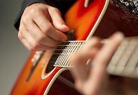 Man Playing Guitar detail close-up