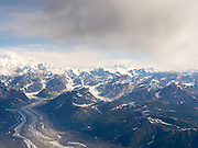 Aerial view of Denali (Mt. McKinley; far left), the Tokositna Glacier (lower left) and the Alaska Range on a sightseeing flight from Talkeetna, Alaska.
