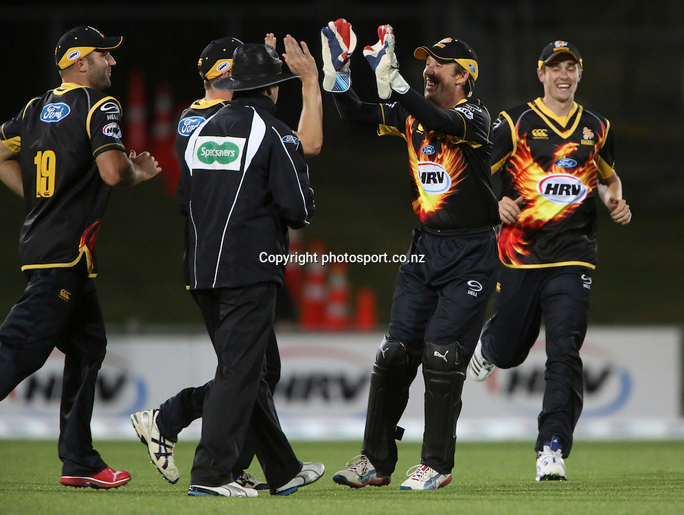 Wellington's Luke Ronchie, right center, celebrates a wicket in the HRV Cup T20 cricket match between the Central Districts Stags and the Wellington Firebirds at McLean Park, Napier, New Zealand. Friday, 07 December, 2012. Photo: John Cowpland / photosport.co.nz