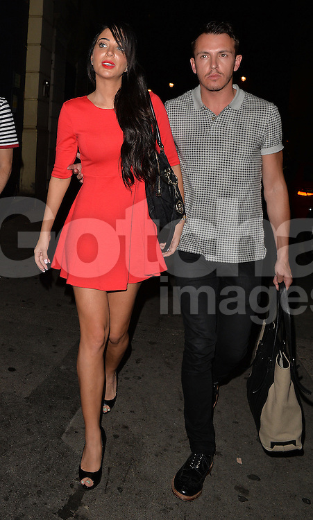 Tulisa Contostavlos and her publicist Simon Jones leaving the Arts Theatre after watching the show 'Some Girl I Used to Know'. London, UK. 12/09/2014<br />