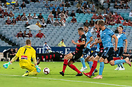 Western Sydney Wanderers forward Oriol Riera(9) gets the ball past Sydney FC goalkeeper Andrew Redmayne (1) to score at the Hyundai A-League Round 8 soccer match between Western Sydney Wanderers FC and Sydney FC at ANZ Stadium in NSW, Australia