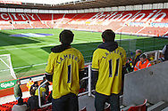 Picture by Paul Chesterton/Focus Images Ltd.  07904 640267.03/03/12.Travelling Norwich fans with Lambert on their shirts survey the Brittania Stadium before the Barclays Premier League match at the Britannia Stadium, Stoke-on-Trent.