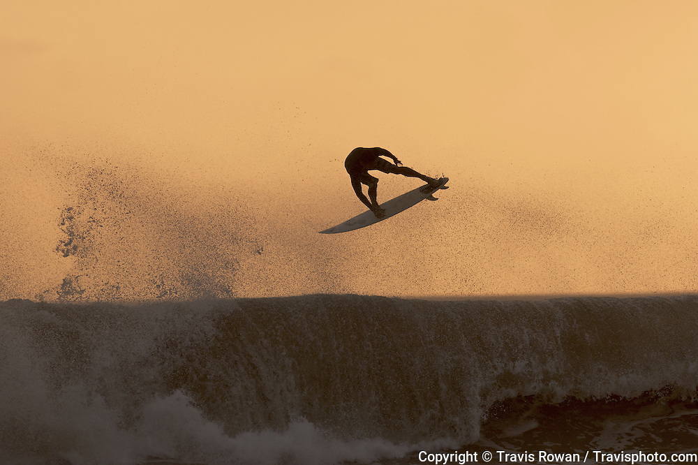 """Professional Balinese surfer, """"Bol"""" stylishly ejects from a close out wave."""